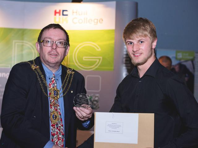 The Lord Mayor of Kingston upon Hull, Councillor Sean Chaytor presenting Chris Wilson with his award.