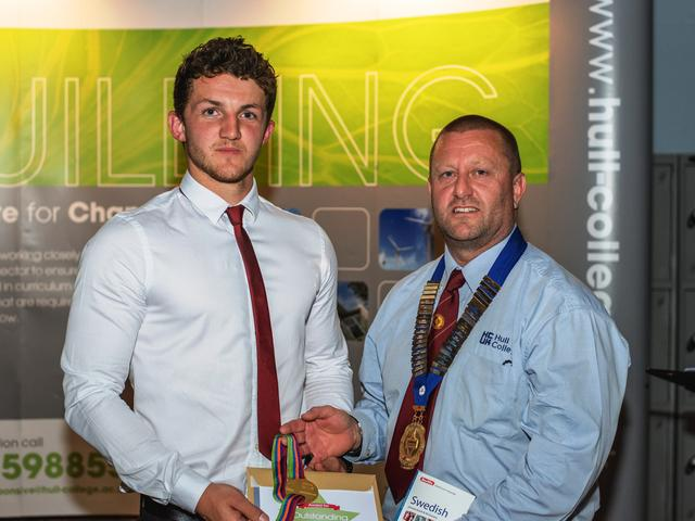 Hull College Group Lecturer Andy Bannister presenting Josh Hunter with his award.